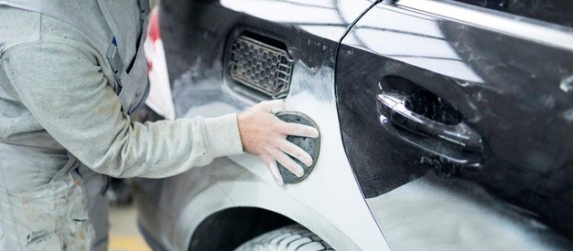 car-painter-preparing-car-painting-workshop_342744-797